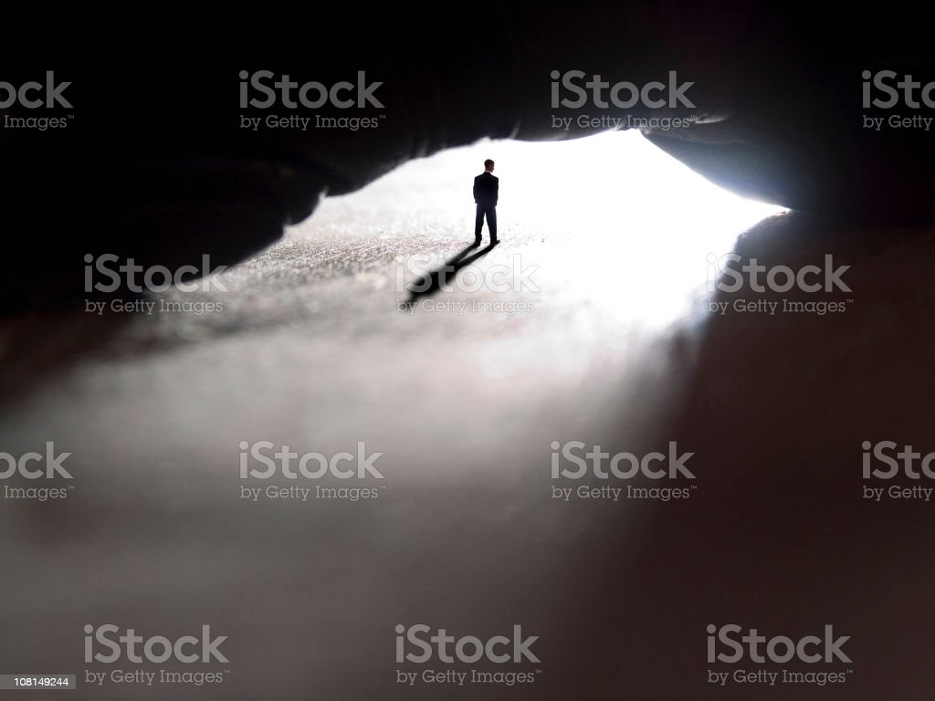 Man Standing in Cave royalty-free stock photo