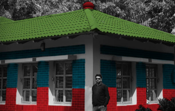Man standing in front of colourful building stock photo