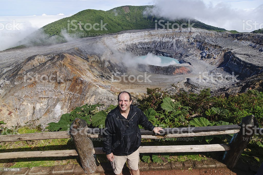 Man standing in front of the Poas Volcano crater stock photo