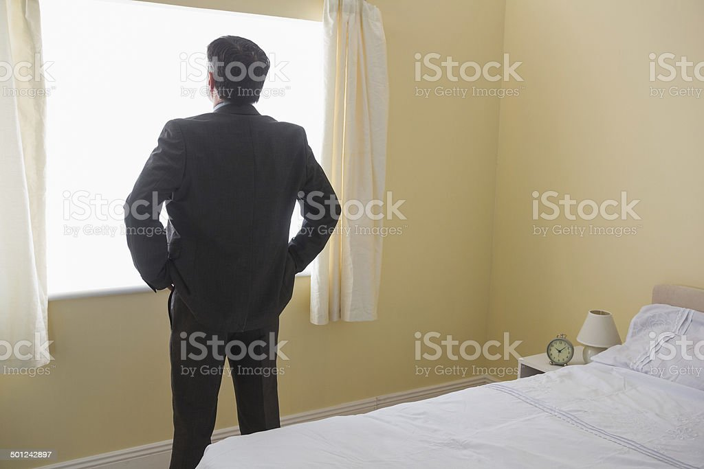 Man standing in front of the window royalty-free stock photo