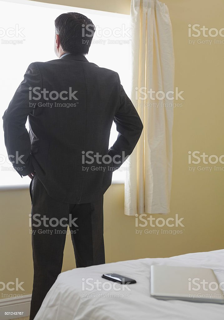 Man standing in front of window royalty-free stock photo
