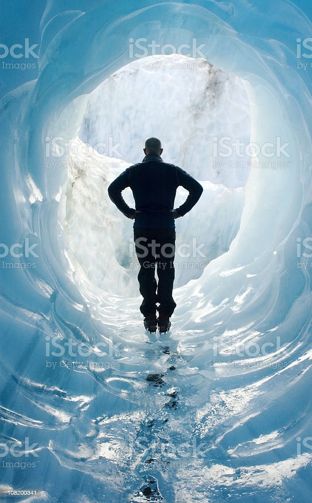 Man Standing in Glacier Ice Cave royalty-free stock photo