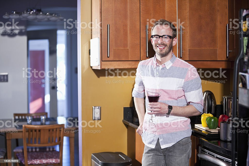 Man standing in kitchen having drink royalty-free stock photo