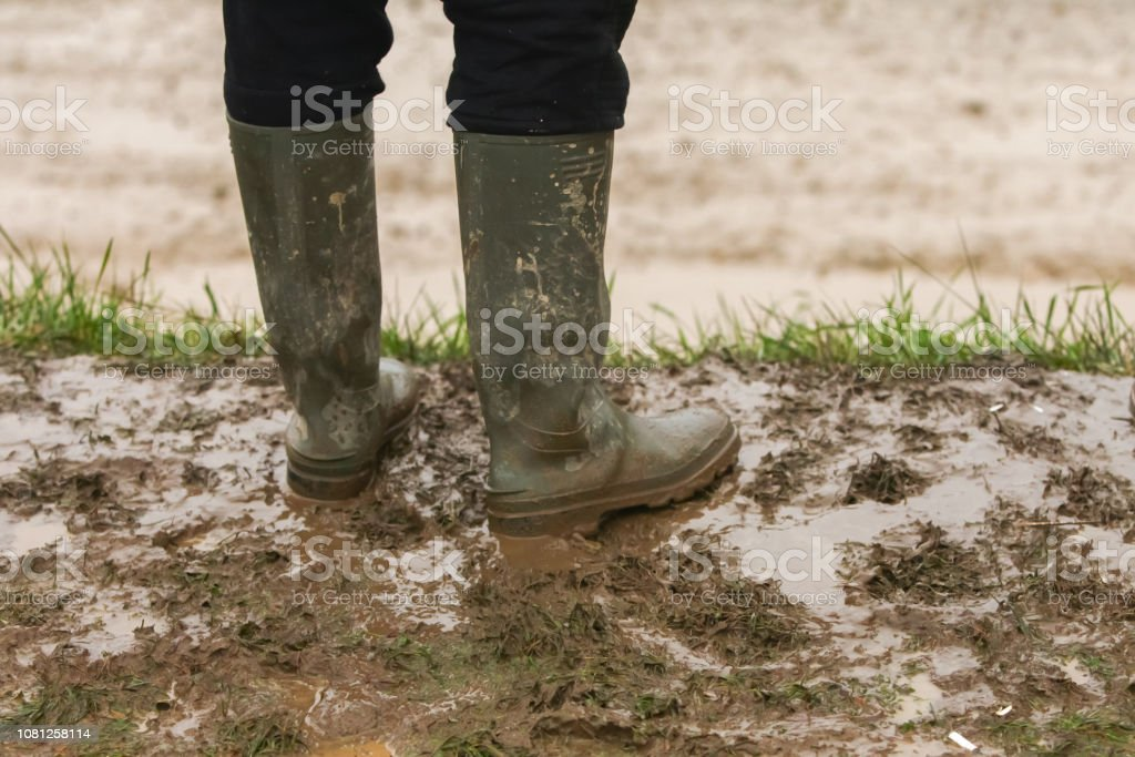 Man standing in mud stock photo