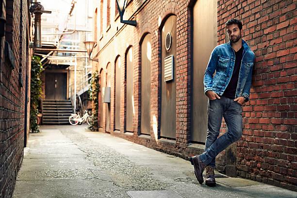 man standing in street wearing denim, portrait - lehnend stock-fotos und bilder
