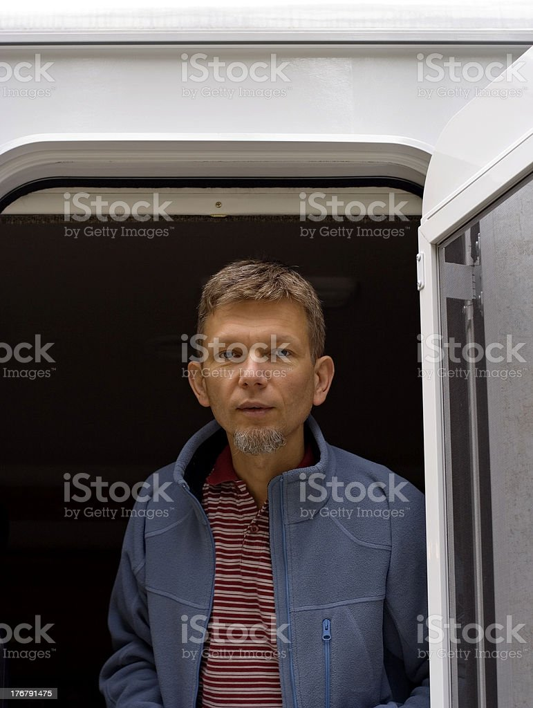 man standing in the door of a motorhome royalty-free stock photo