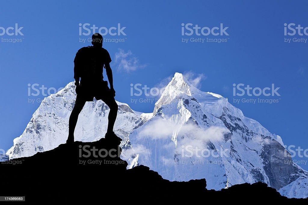 Man standing in the Himalayas mountain range stock photo