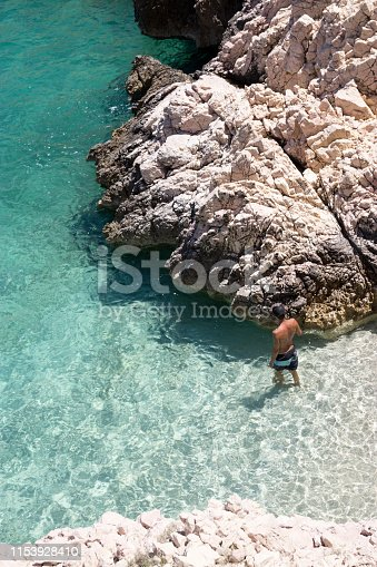 Man standing in the sea from above