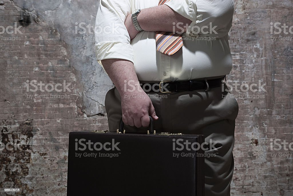 Man standing in warehouse royalty free stockfoto