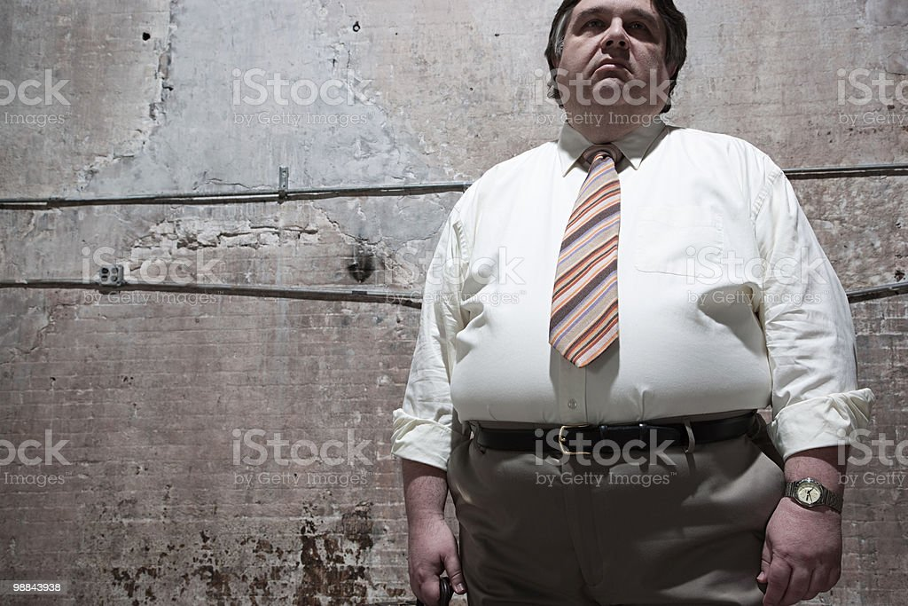 Man standing in warehouse royalty-free stock photo