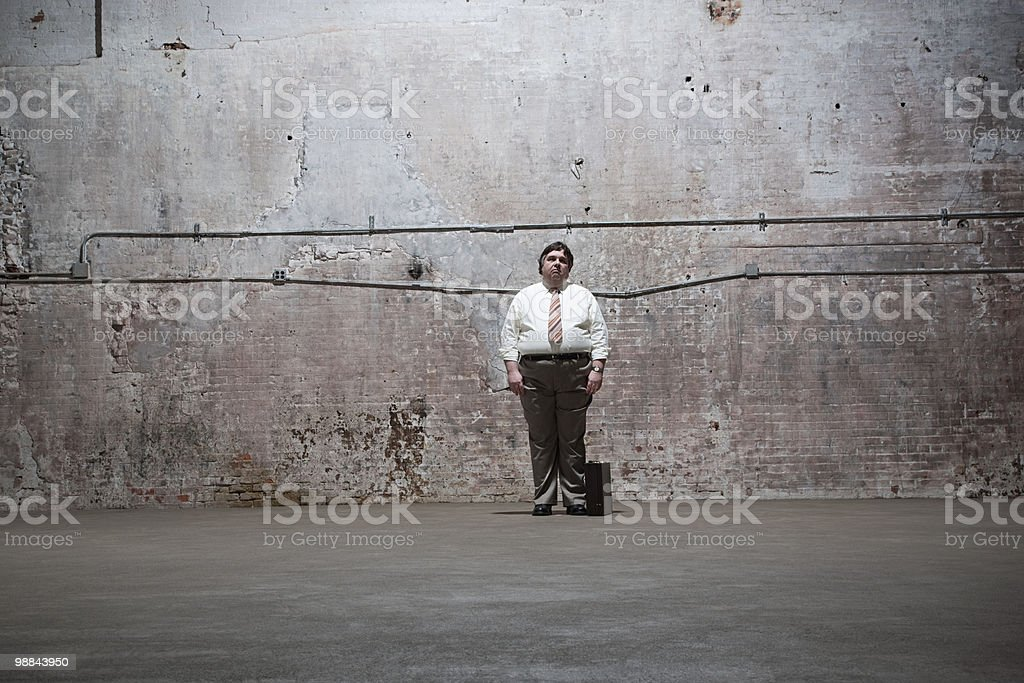 Man standing in warehouse royalty-free 스톡 사진