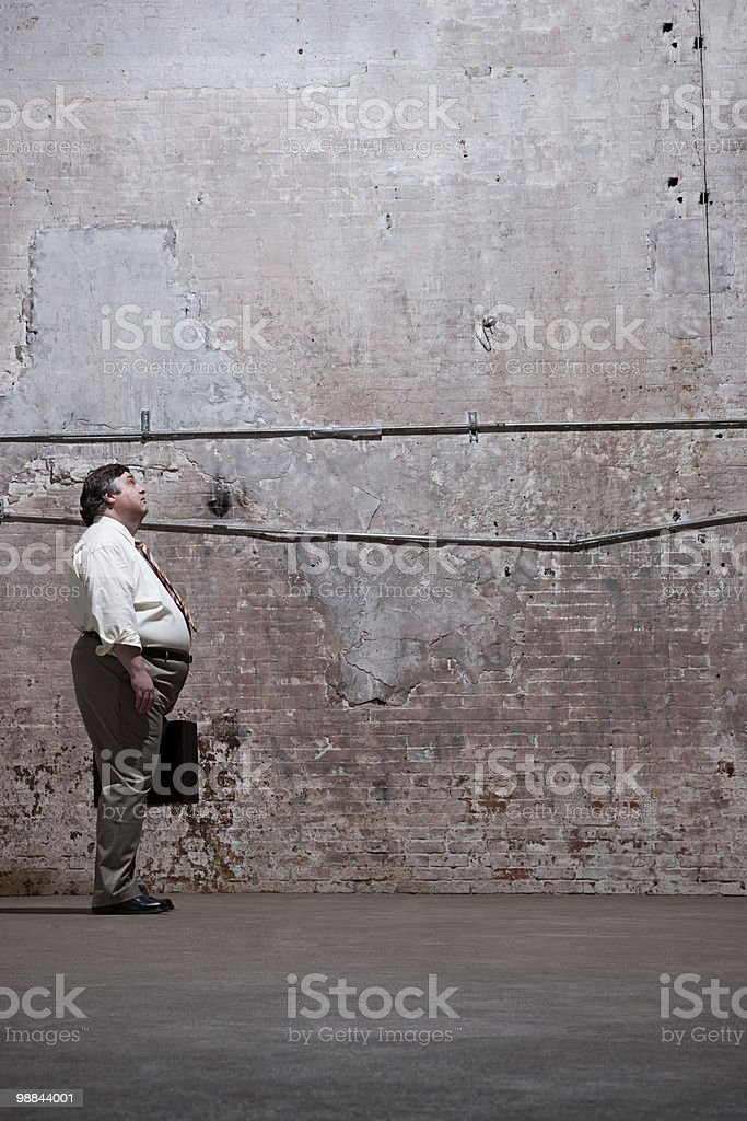 Man standing in warehouse 免版稅 stock photo