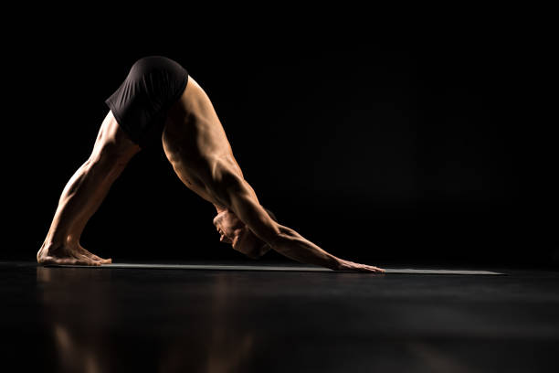 Man standing in yoga position stock photo