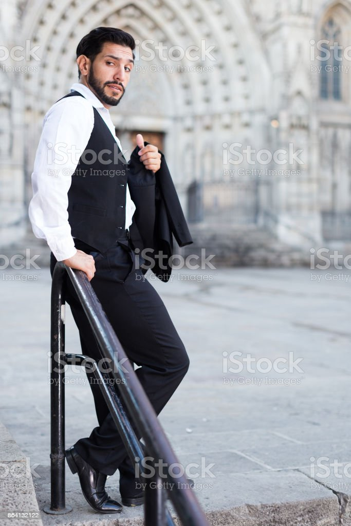 Man standing near iron handrails royalty-free stock photo