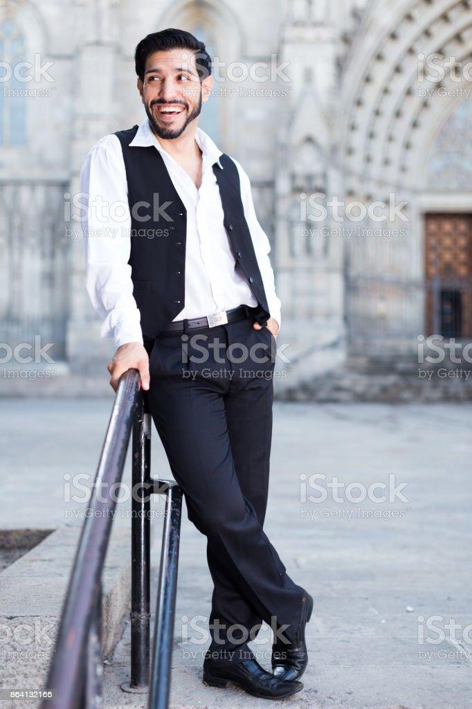 Man standing near iron handrails royalty-free stock photo