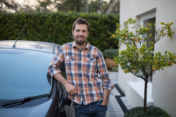 Man standing near the car stock photo