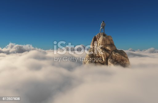 istock Man standing on a stone cliff 612507606