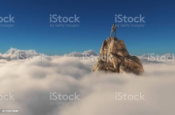 Photo of Man standing on a stone cliff