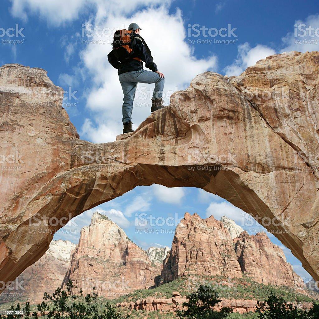 XXXL man standing on arch stock photo