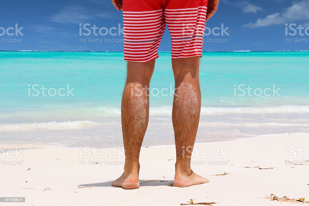 Man standing on Beach stock photo