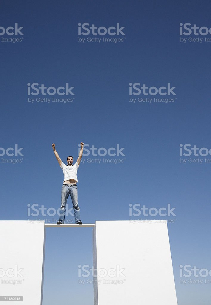Man standing on board between two walls outdoors royalty-free stock photo