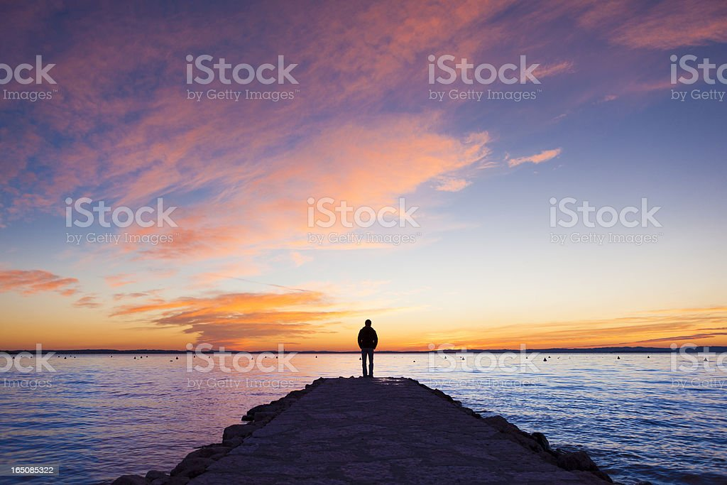 Man standing on jetty royalty-free stock photo