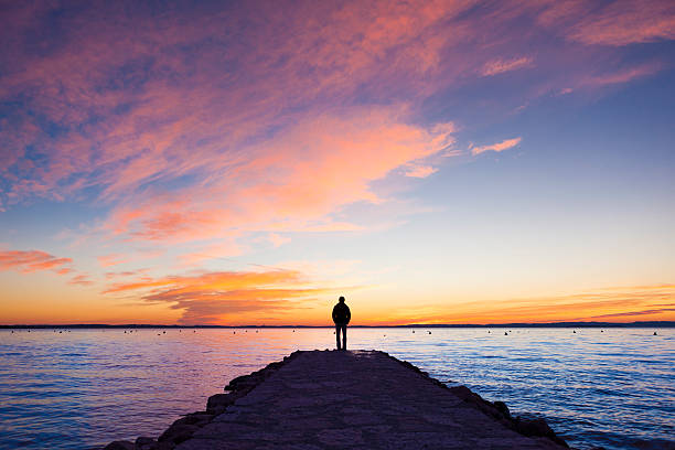 man standing on jetty - one man only stock pictures, royalty-free photos & images