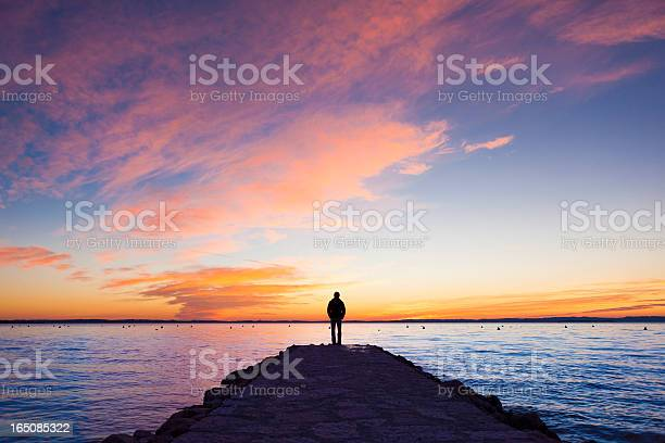 Photo of Man standing on jetty