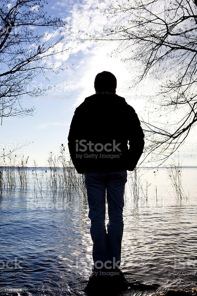 Man standing on lake royalty-free stock photo