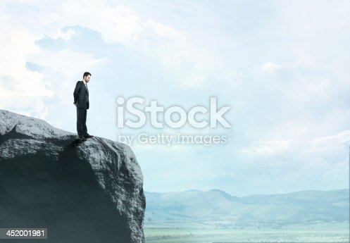 istock man standing on  rock 452001981