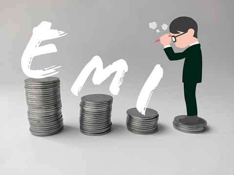 EMI , equated monthly installment Man thinking about payment