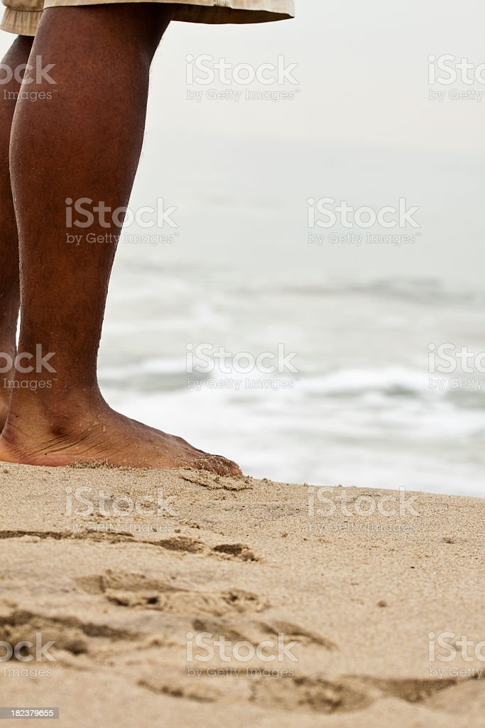 Man standing on the  beach stock photo
