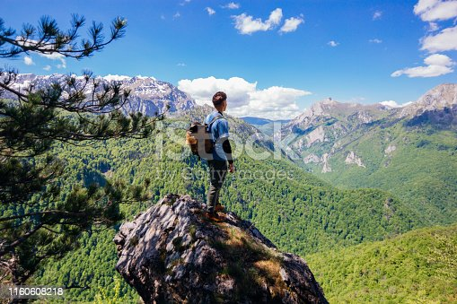 Young male hiker enjoining the view