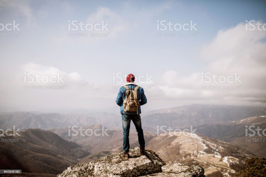Man standing on the mountain top stock photo