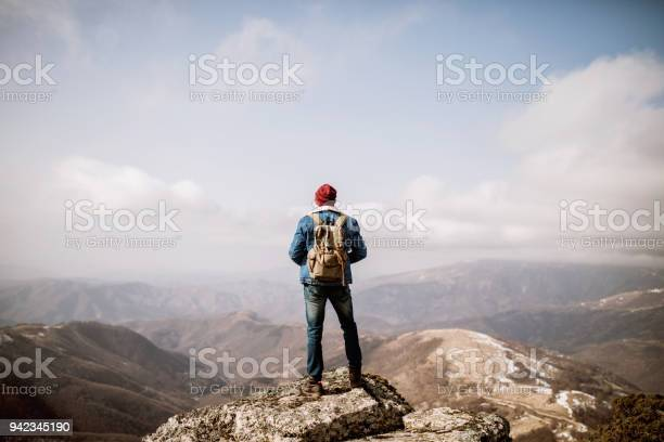 Photo of Man standing on the mountain top