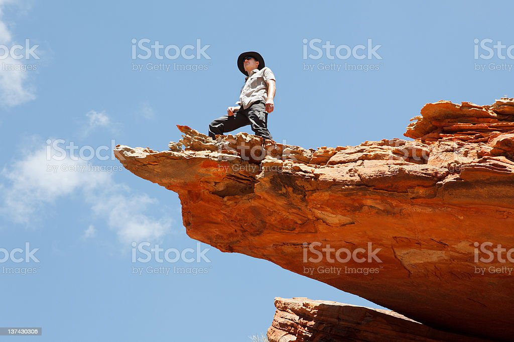 Man standing on the rock edge royalty-free stock photo