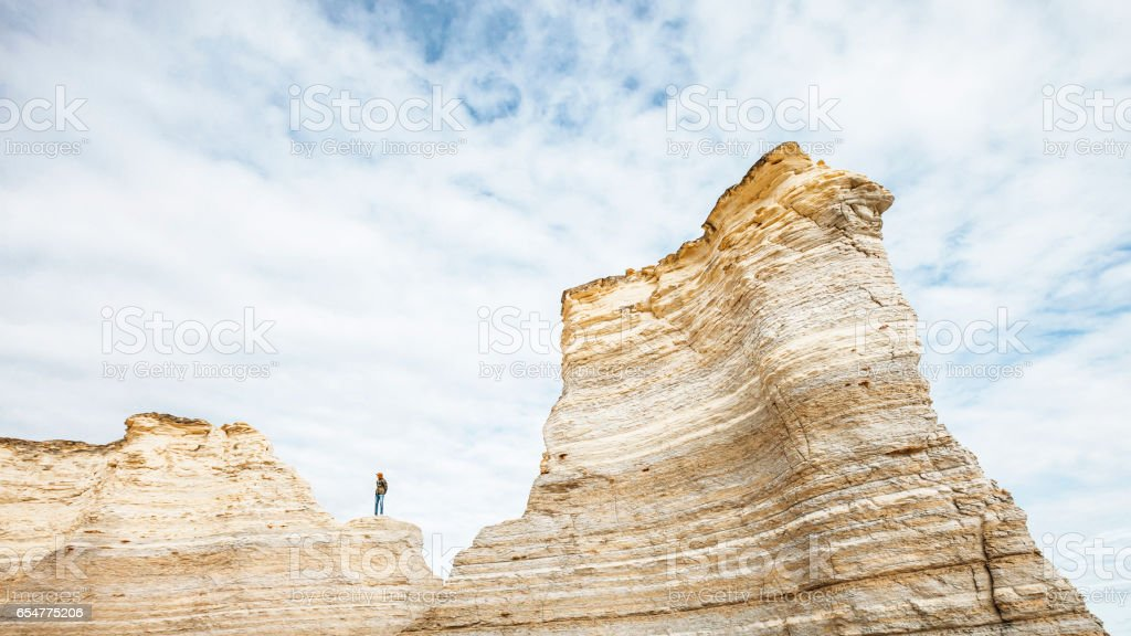 Man standing on the rocks, Kansas. stock photo
