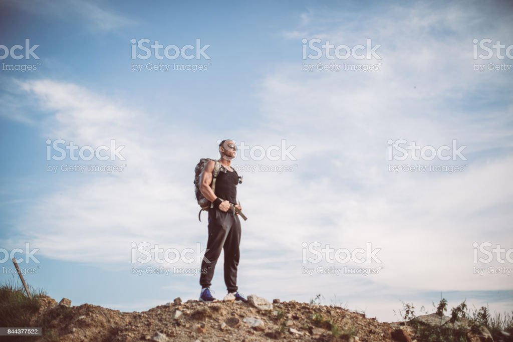 Man standing on the top of a mountain stock photo