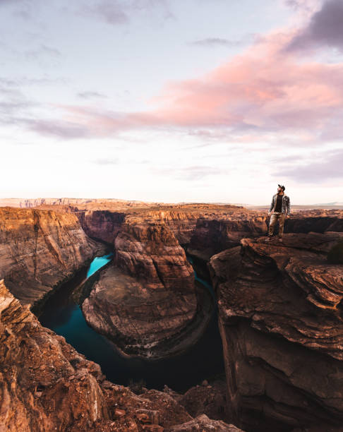 man standing on top of the horseshoe bend in usa man standing on top of the horseshoe bend in usa page arizona stock pictures, royalty-free photos & images