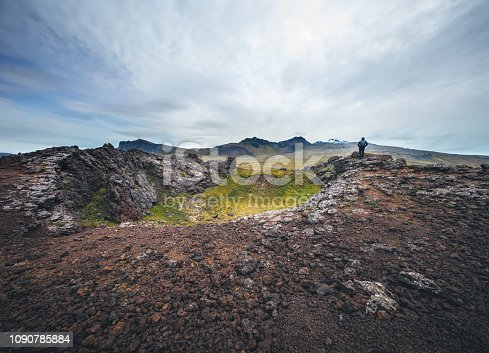 Man standing on the top of volcanic crater (Saxholl crater, Snæfellsnes Peninsula, west Iceland).