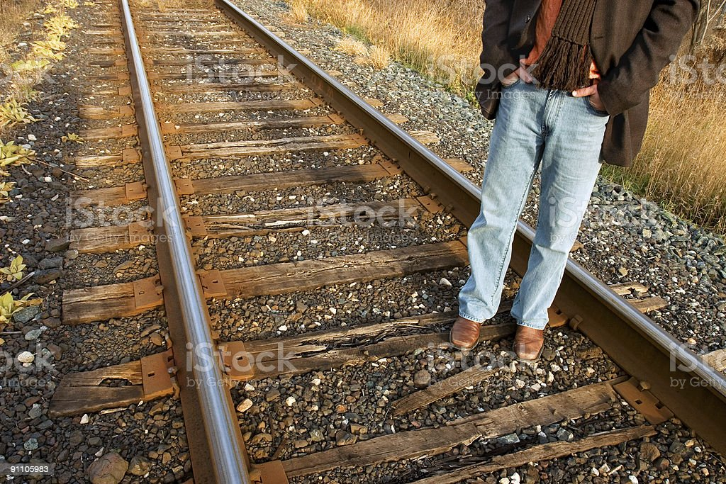 man standing on train tracks royalty-free stock photo