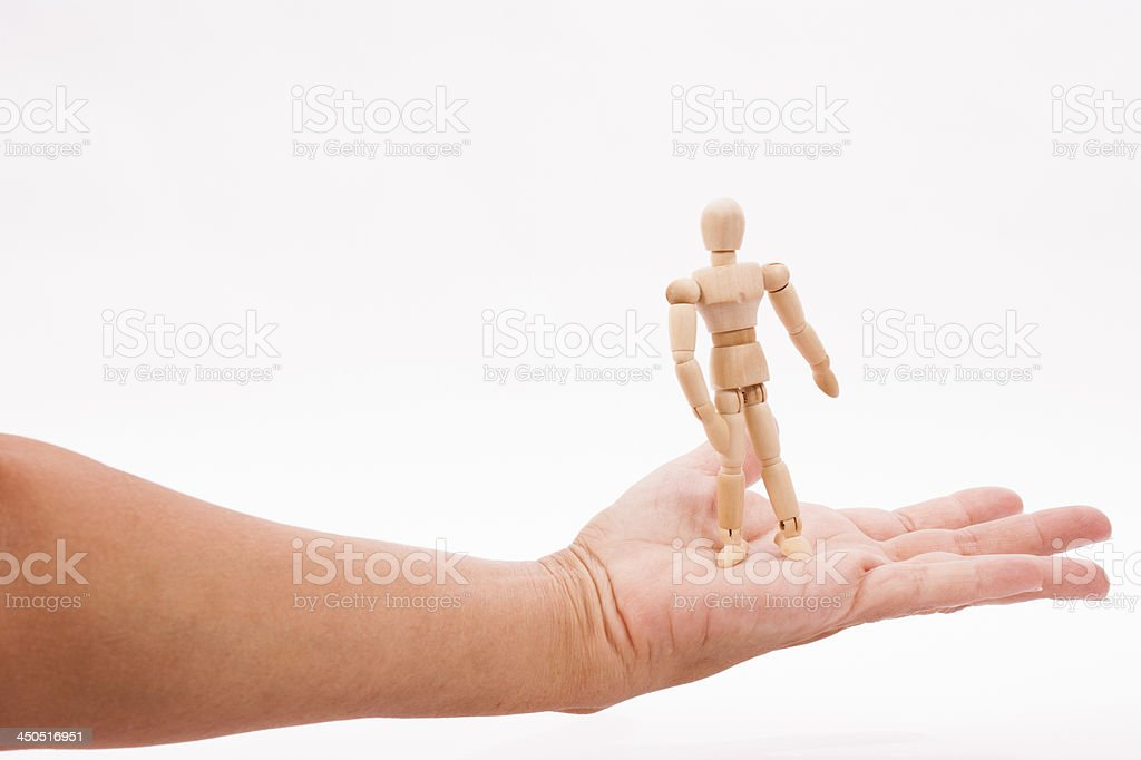man standing on woman's palm clipping path stock photo