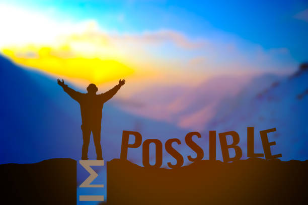 man standing over impossible or possible over cliff on sunset background - possible stock photos and pictures