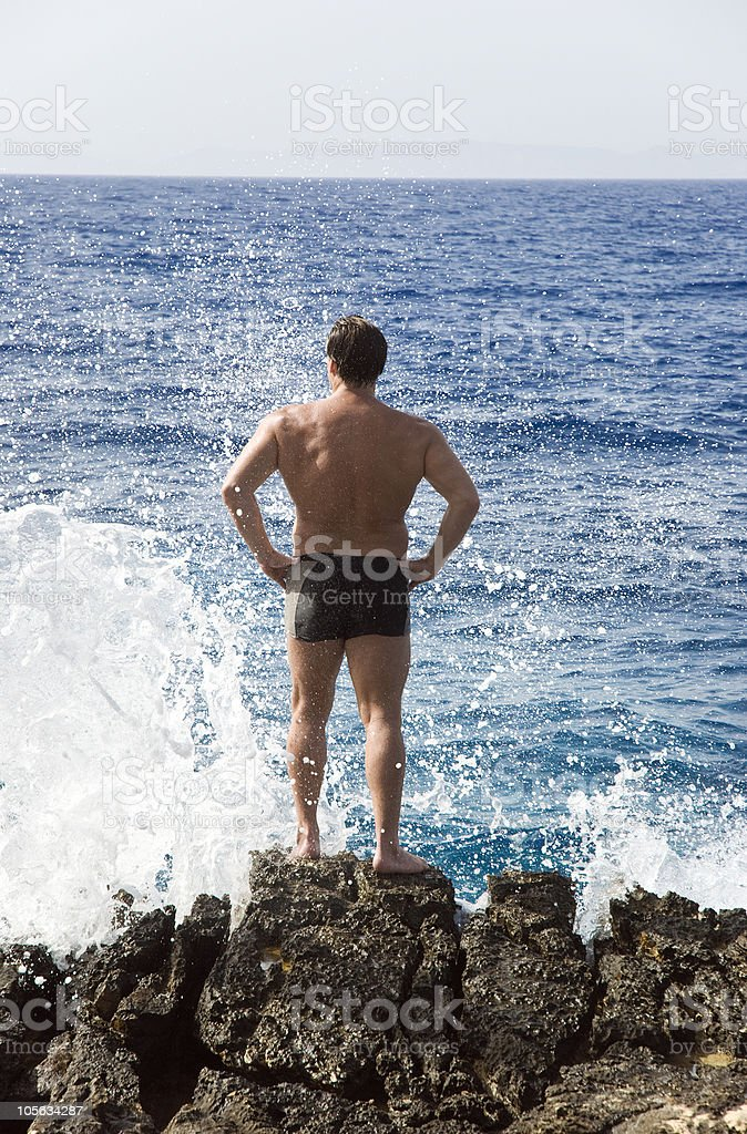 man standing rocks stock photo