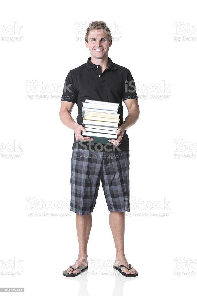Man standing with a stack of books stock photo