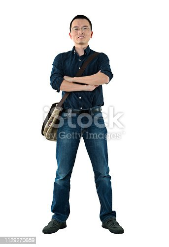 istock Man standing with arms crossed 1129270659