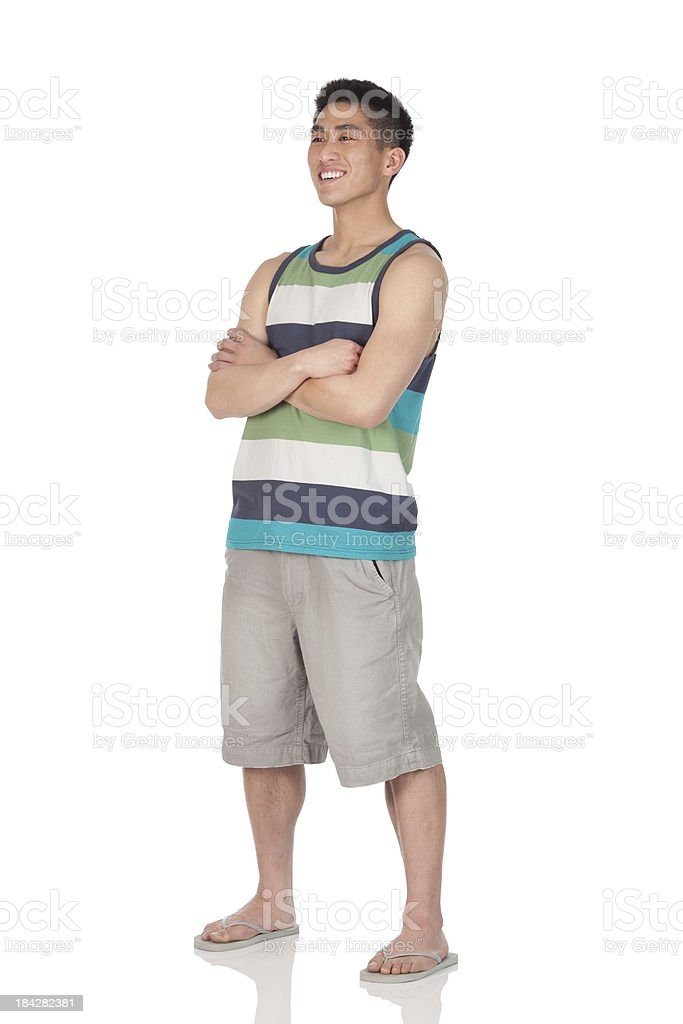 Man standing with arms crossed stock photo