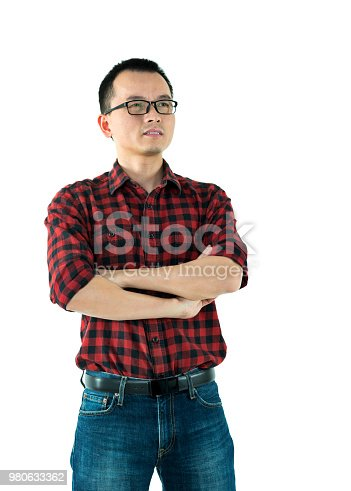 istock Man standing with arms crossed 980633362