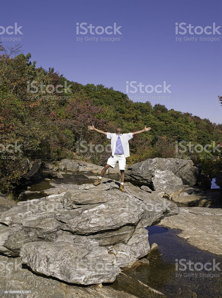 Man standing with arms outstretched don rock 免版稅 stock photo