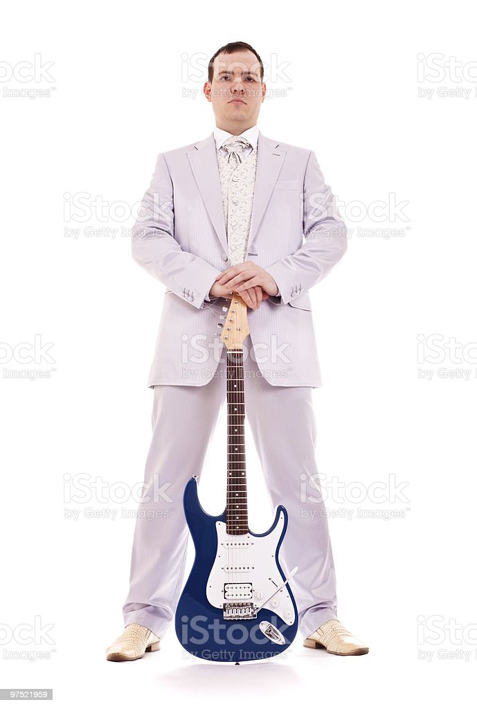 man standing with electro guitar royalty-free stock photo